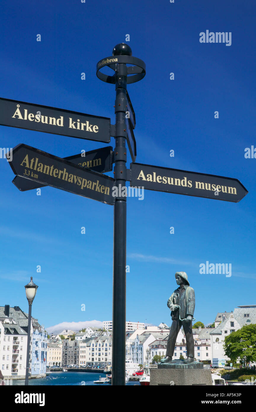 Sign post and Fisher Boy statue, Alesund, More og Romsdal, Norway - Stock Image