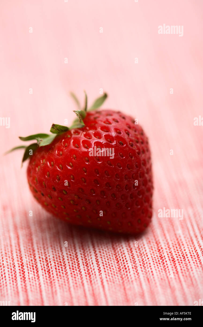 Strawberry on Tablecloth - Stock Image