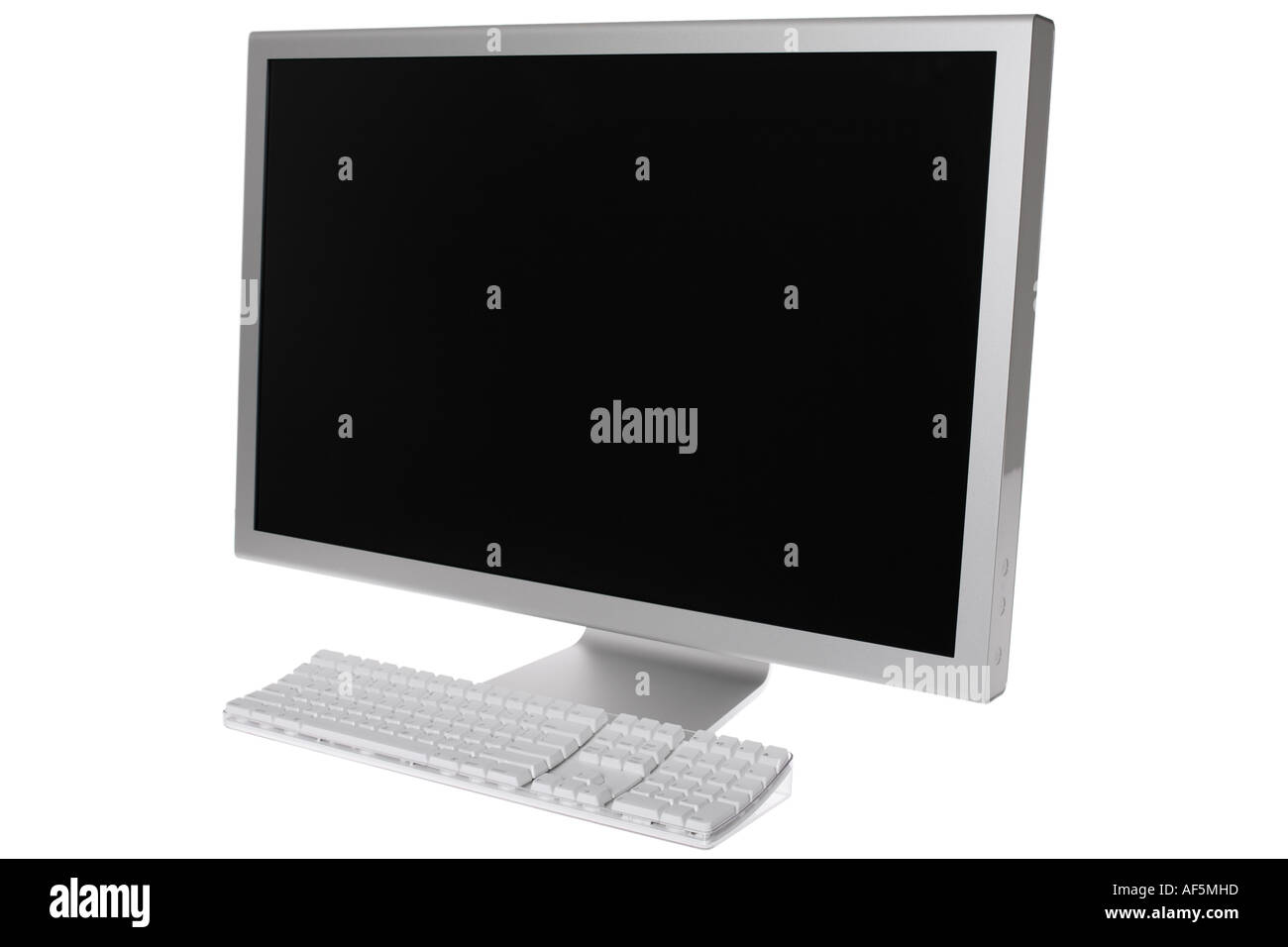 Modern widescreen computer monitor and keyboard - Stock Image