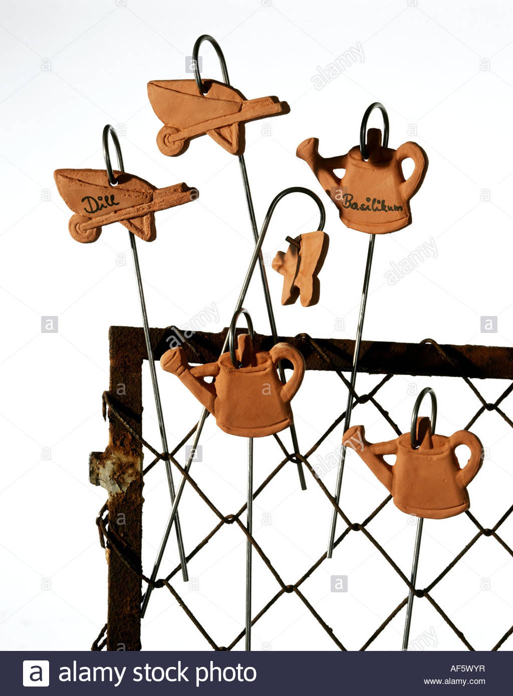 Small Terracotta Garden Tools As Name Labels For Plants