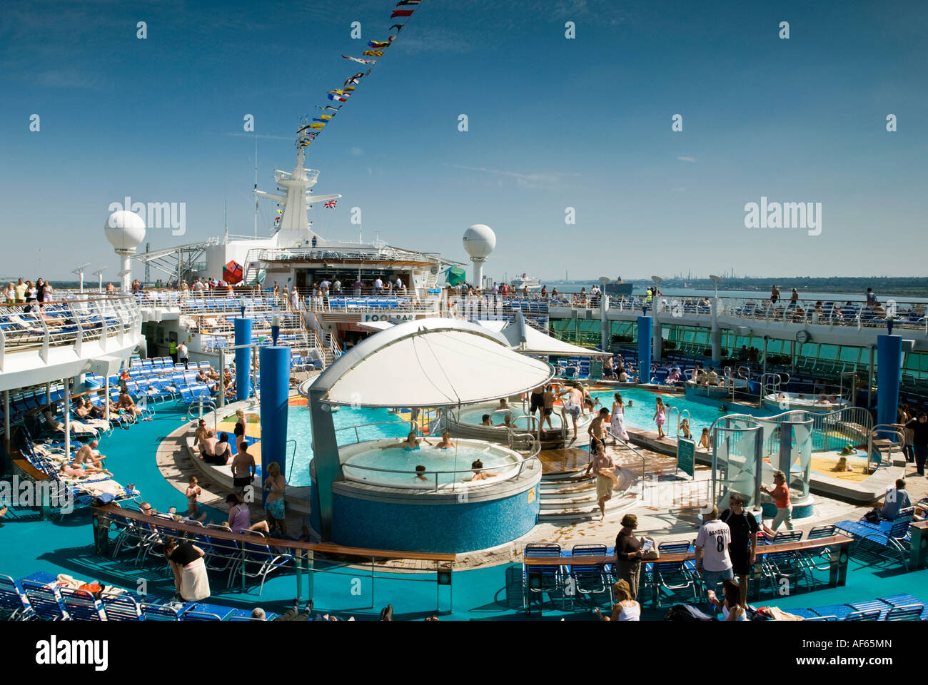 The massive  seawater swimming pool area on a cruise liner - Stock Image