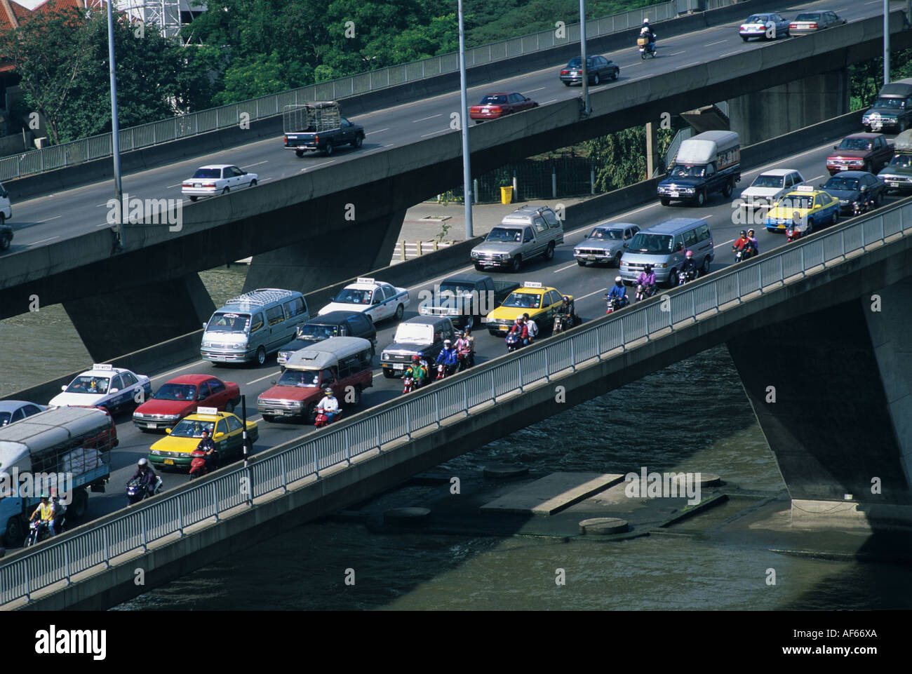 Rush hour traffic jam over the Chao Phraya River bridge in central Bangkok Thailand Stock Photo