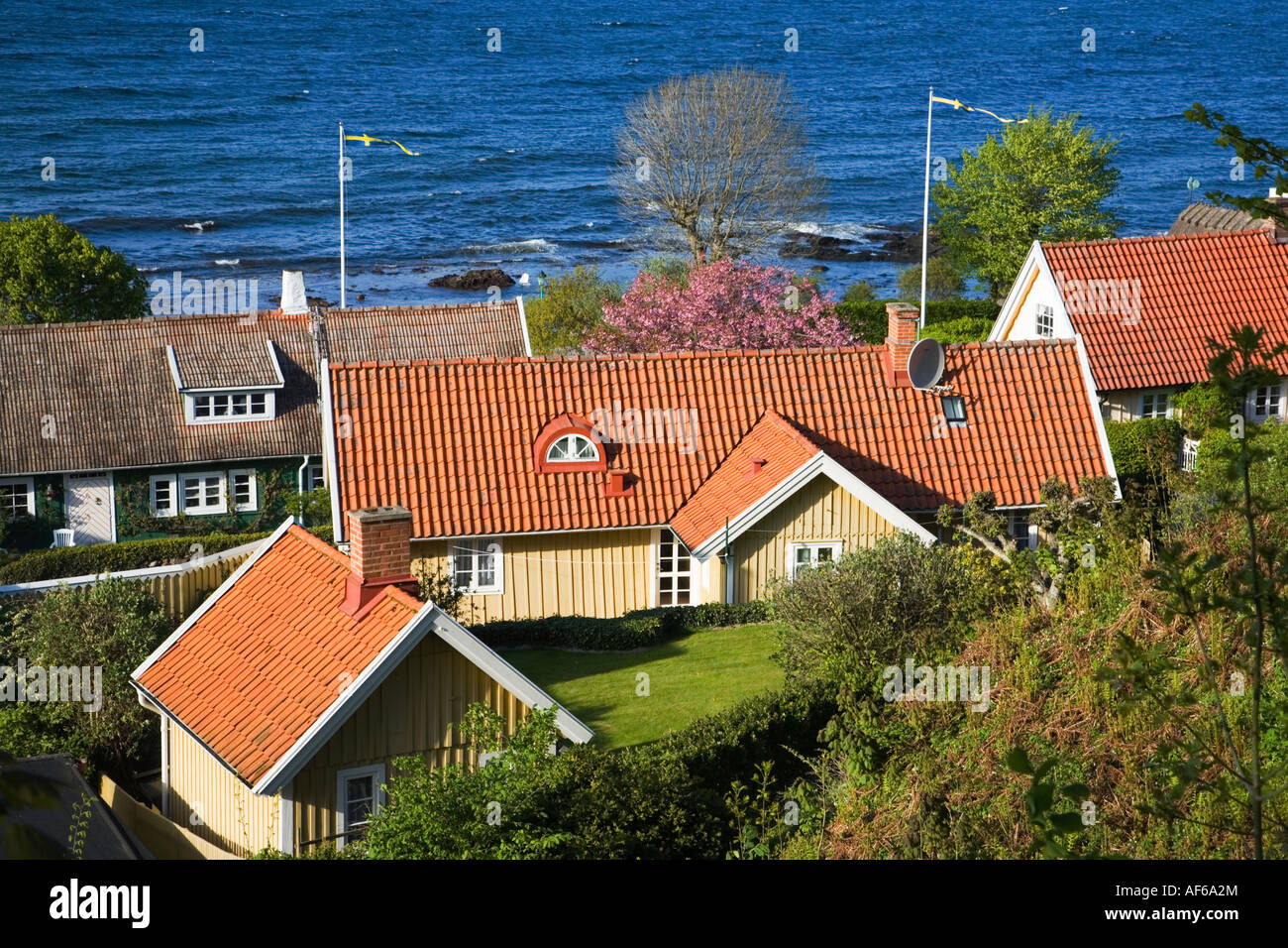 Sweden Skåne Scania Kullen Viken houses swedish national flag and scenic coastline May 2006 - Stock Image