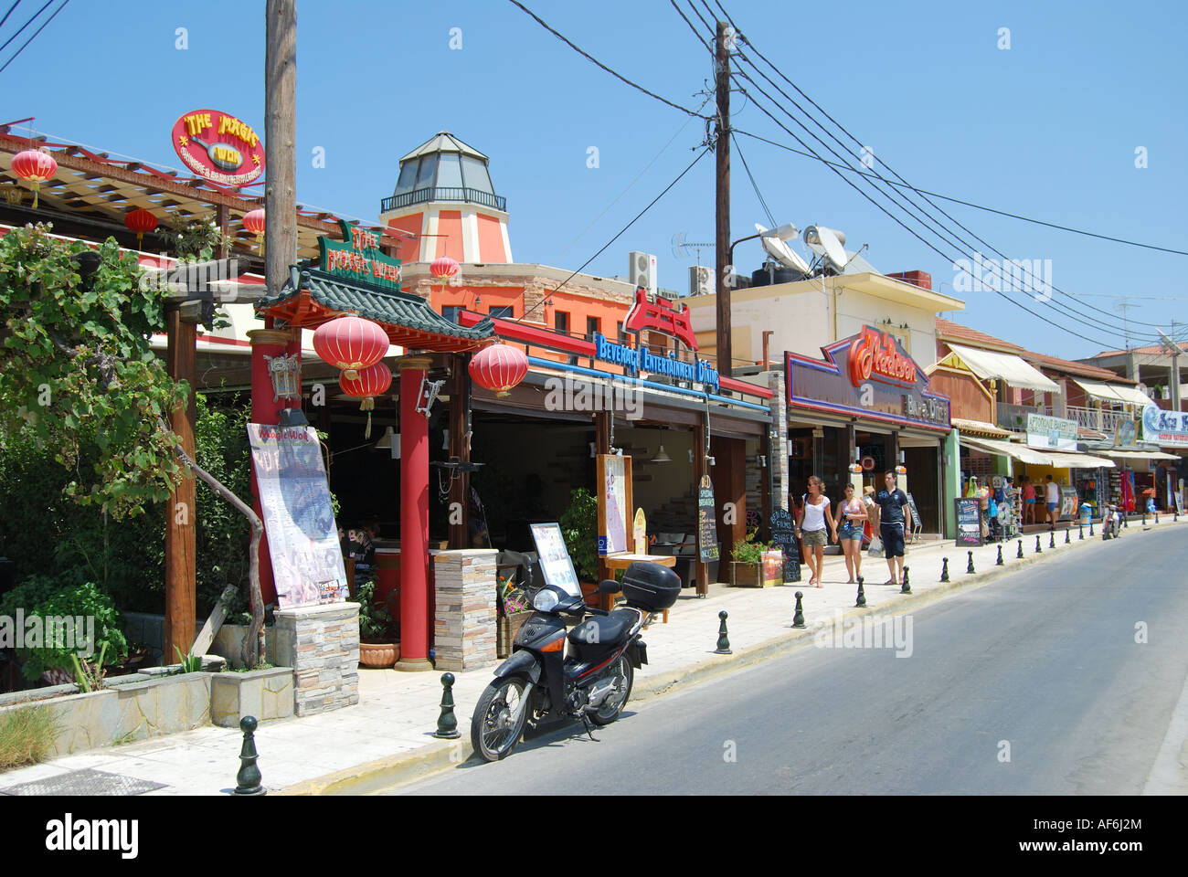 Tourist restaurants and bars, Street promenade, Sidari, Corfu, Ionian Islands, Greece - Stock Image