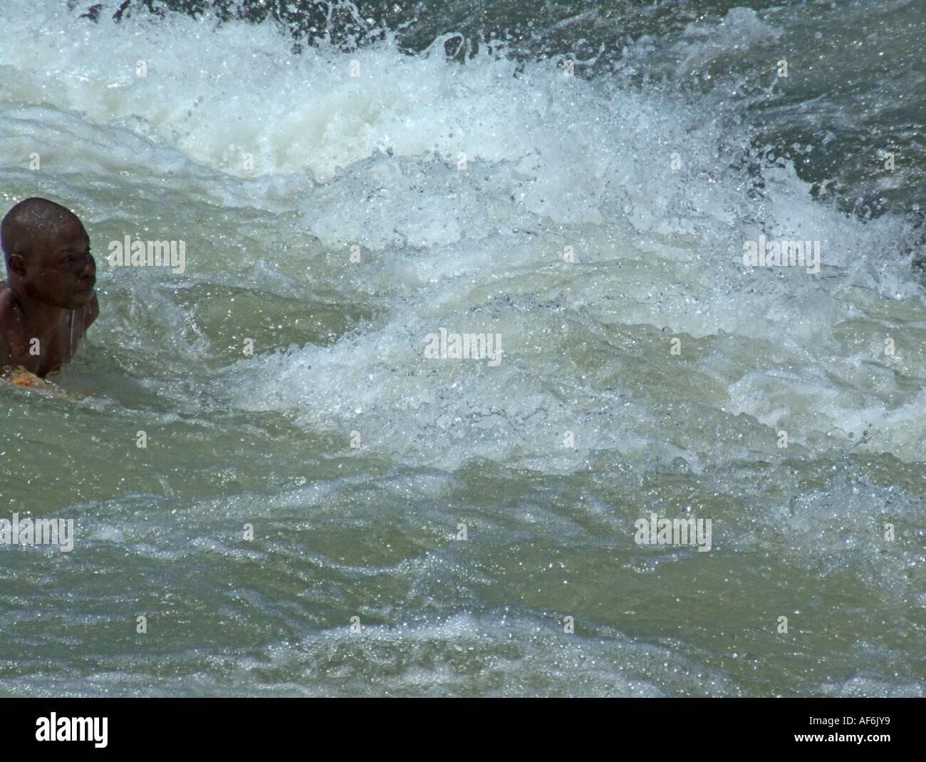 Daredevil braving the rapids at Bujjagali Falls near the source of the River Nile - Stock Image
