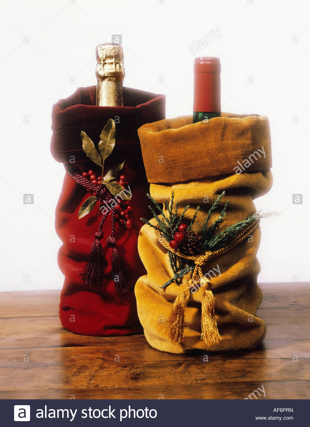 Champagne and Wine Bottles in Christmas Gift Bags Stock Photo ...