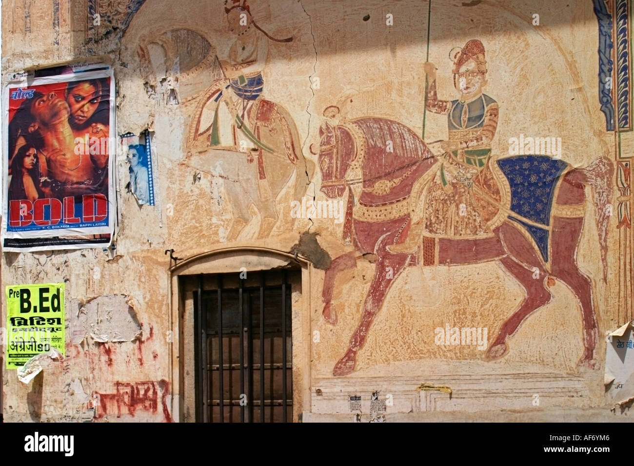 Historic paintings and modern poster on wall of haveli Nawalgarh Rajasthan India South Asia - Stock Image
