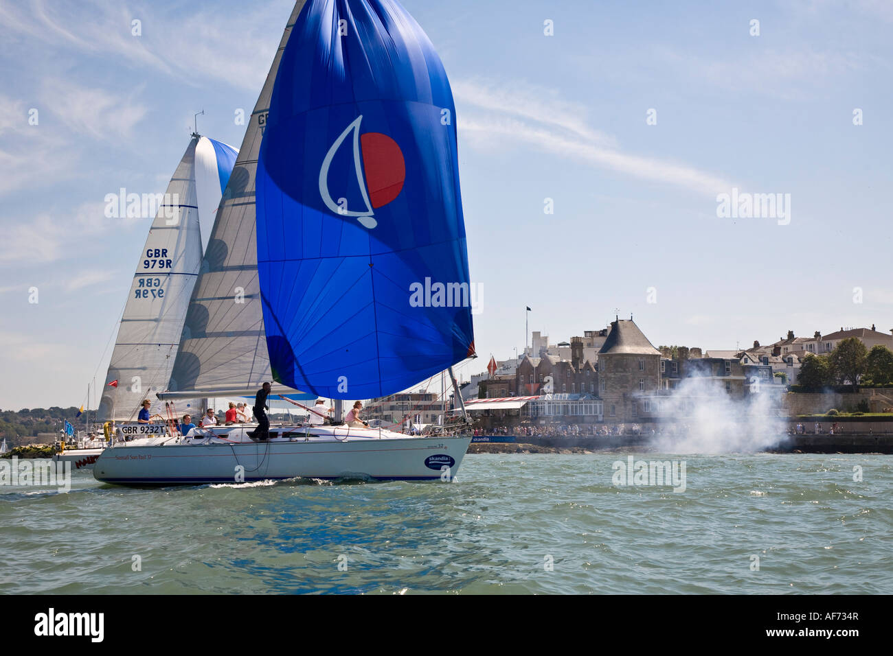Spinnaker sails flown on yachts finishing race during Cowes week racing Isle of Wight Solent Hampshire England August - Stock Image