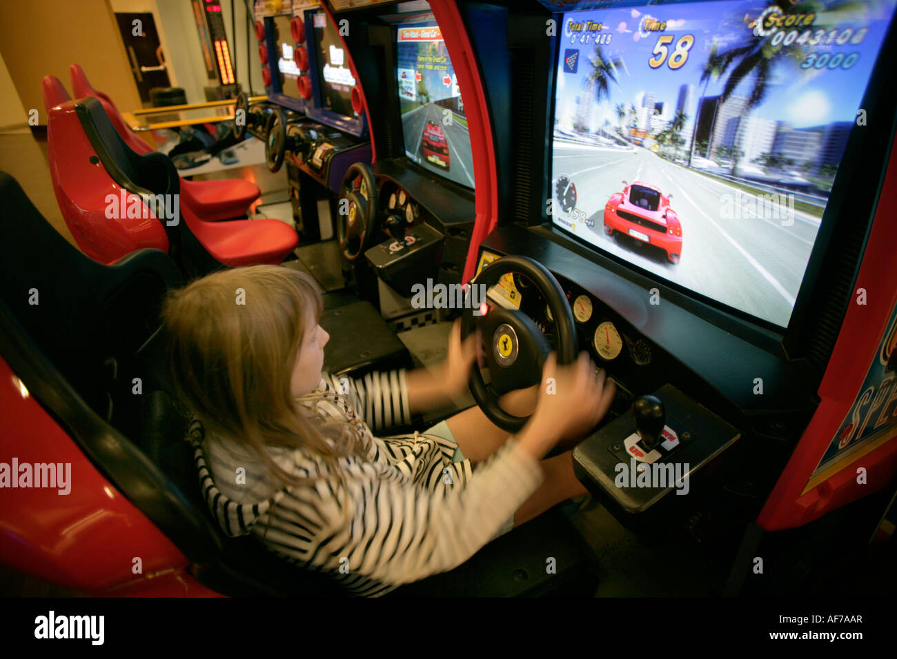 Nine Year Old Girl Playing Car Racing Simulation In Video Games