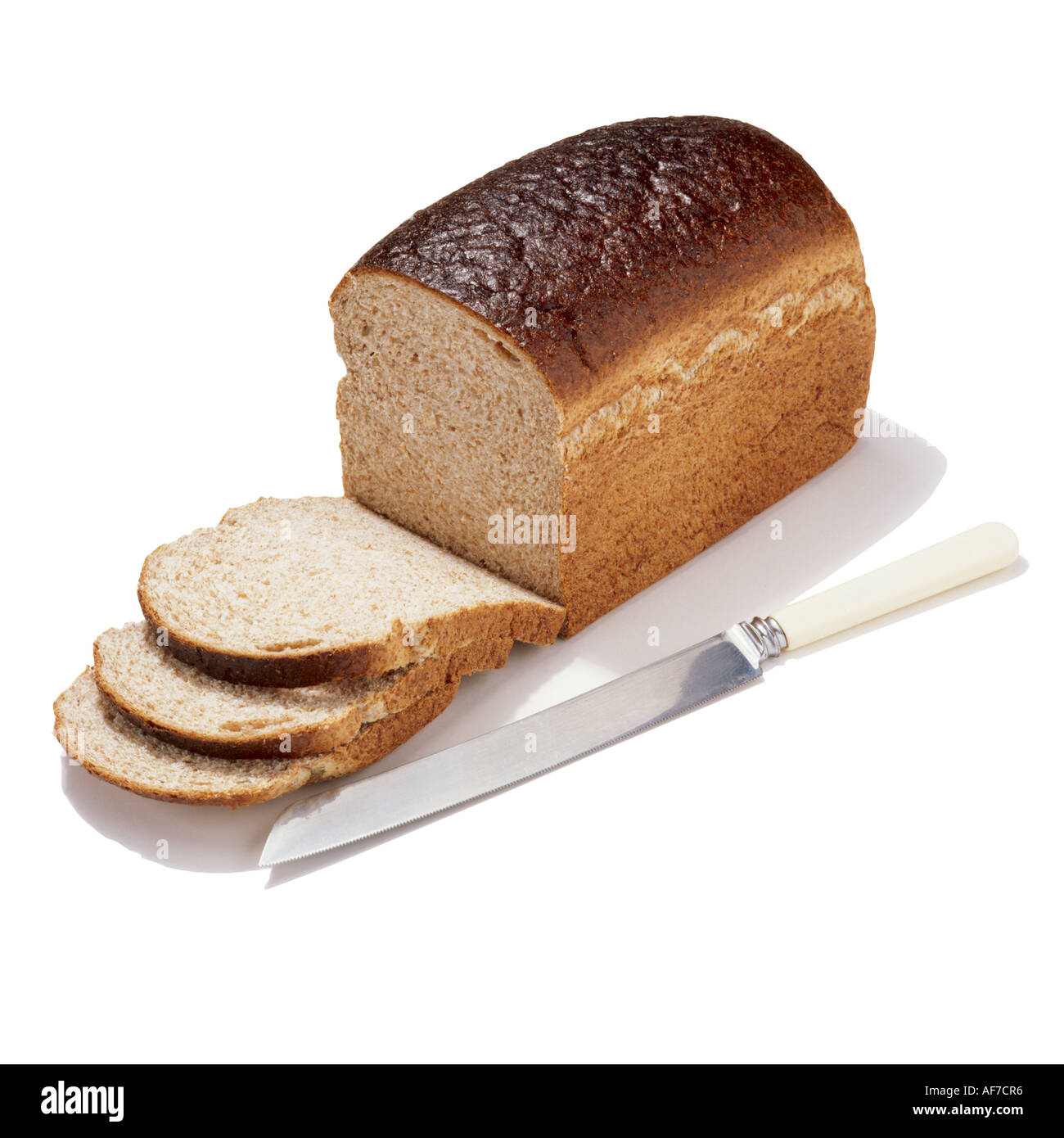 A loaf of bread and bread knife - Stock Image