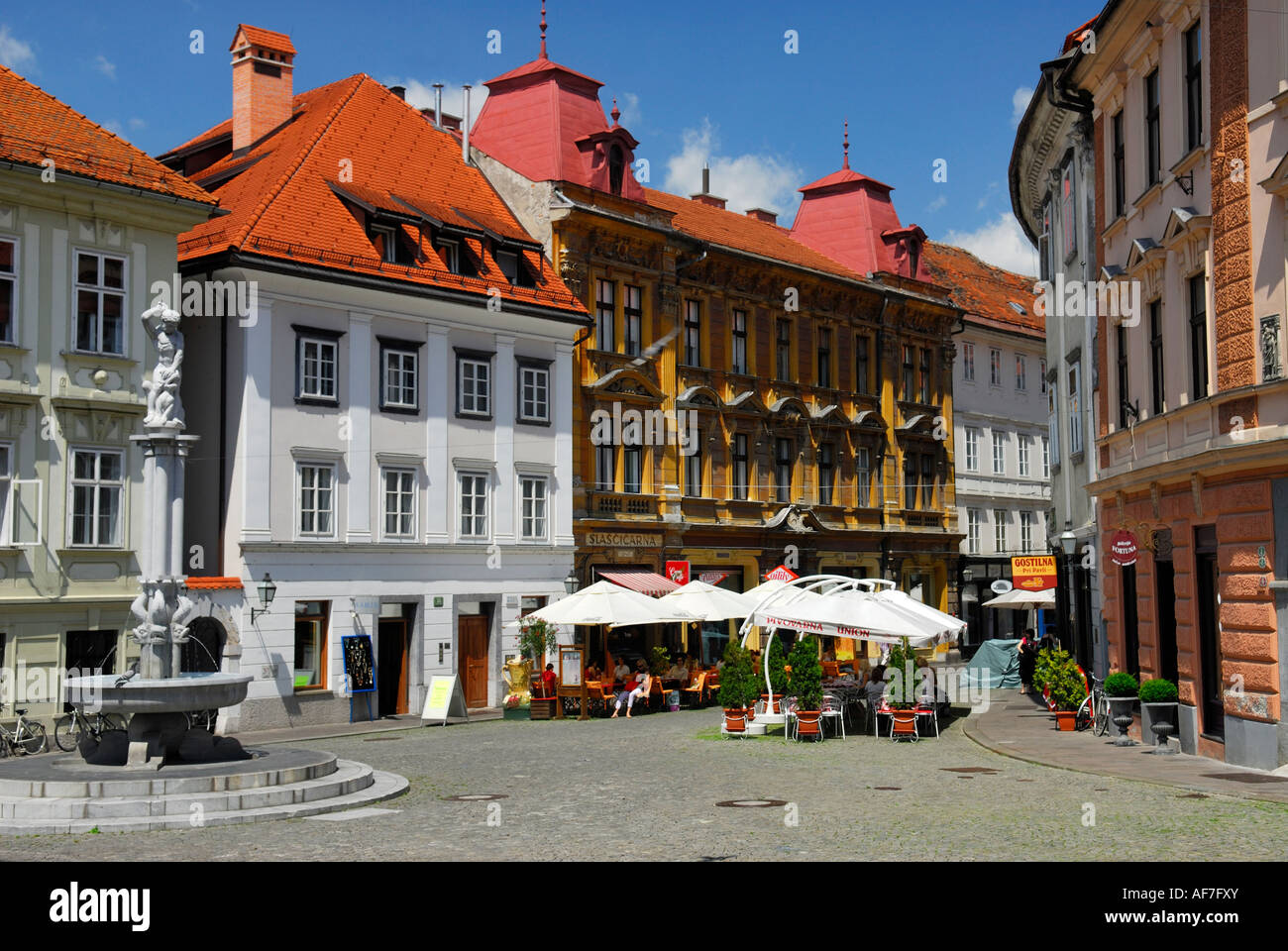 Street cafes and fountain in Old Town Ljubljana Slovenia - Stock Image
