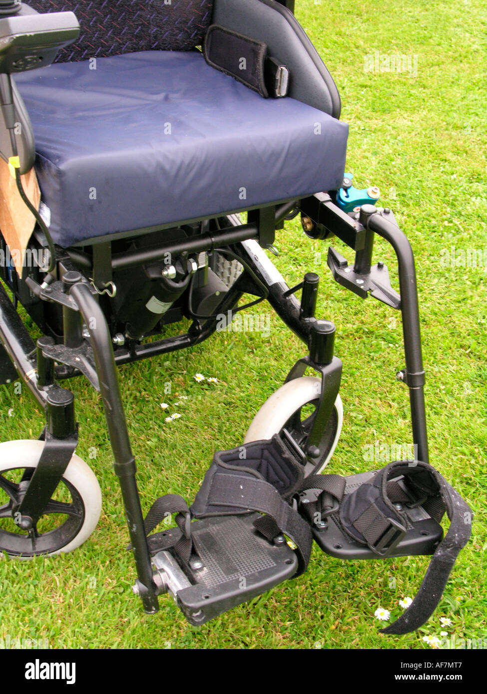 spectra plus battery powered wheelchair - showing the foot rest with velcro straps for supports - Stock Image