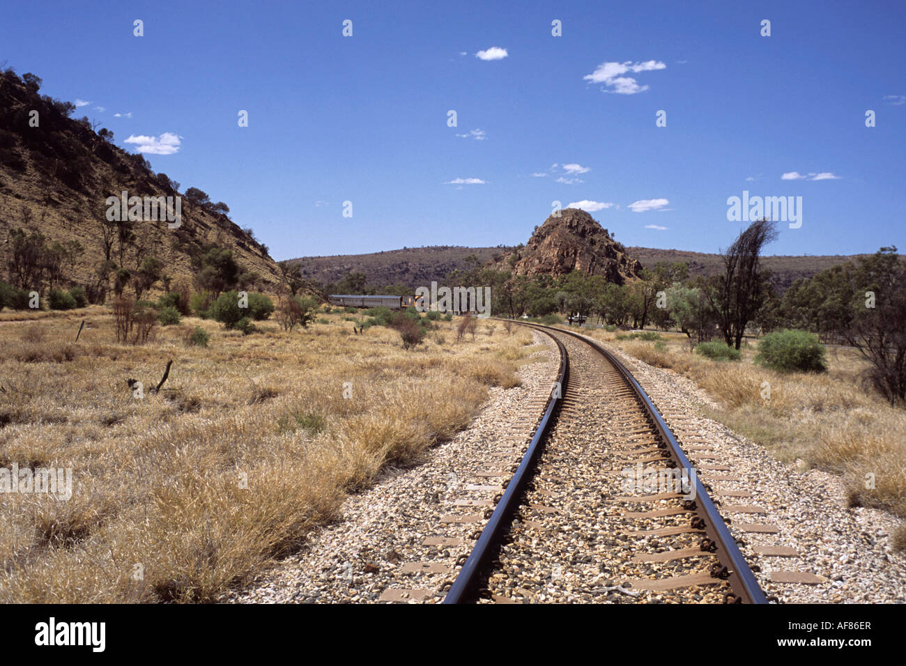 Train Tracks and The Ghan Train, Near Alice Springs, Northern Territory, Australia - Stock Image