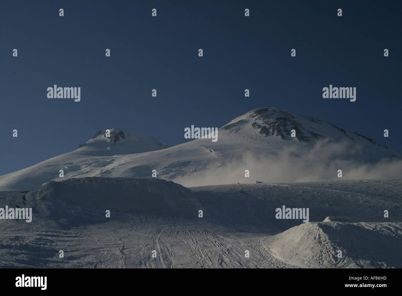 Mountains landscape 25 - Evening Elbrus in pure blue sky and snowboard big-airs, Caucasus, Elbrus region, Kabardino-Balkari - Stock Image