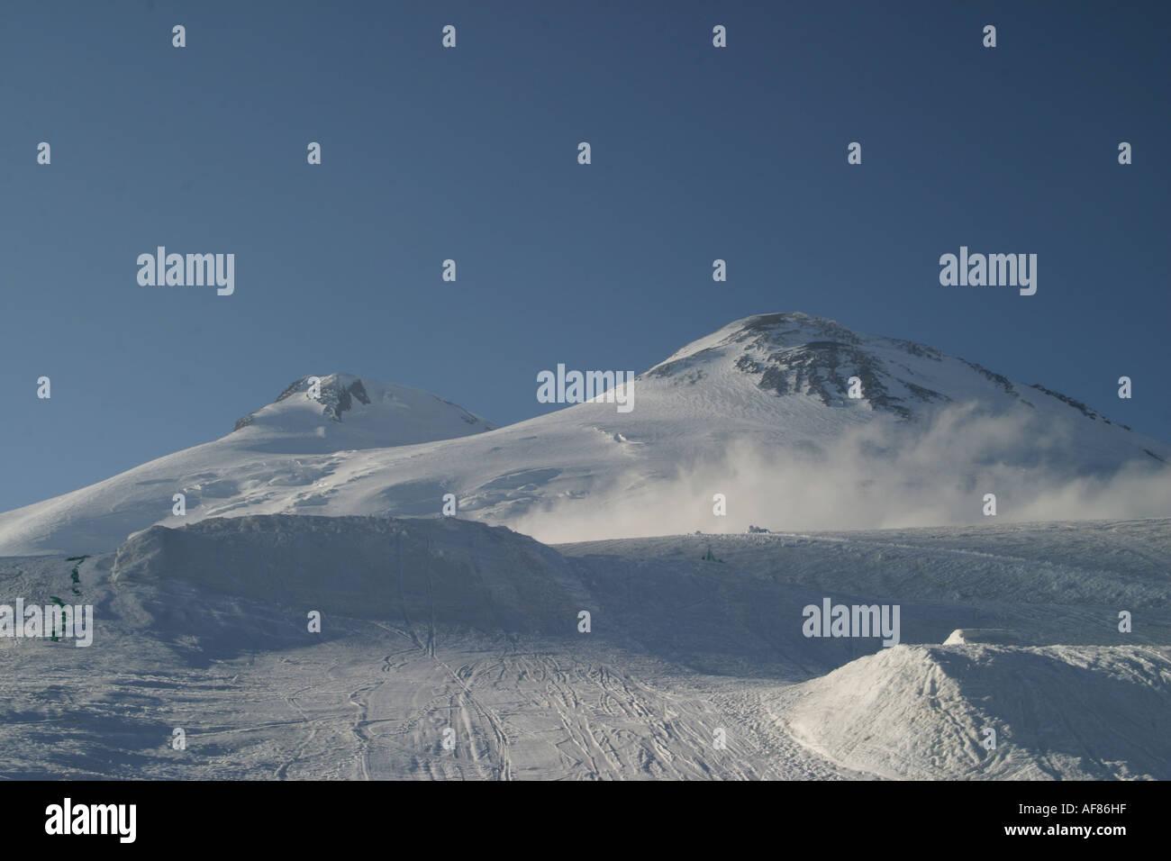 Mountains landscape 24 - Evening Elbrus in pure blue sky and snowboard big-airs, Caucasus, Elbrus region, Kabardino-Balkari - Stock Image