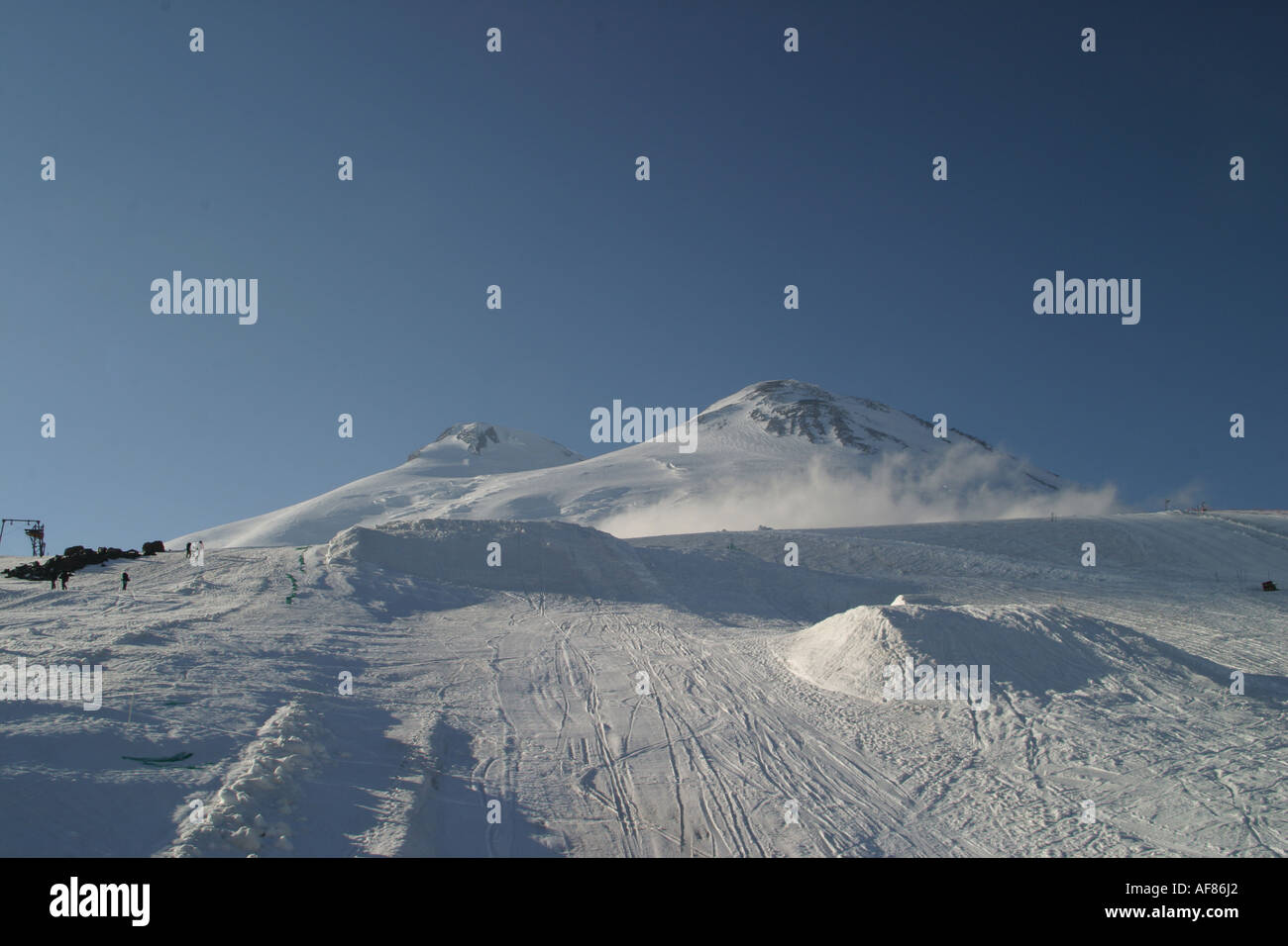 Mountains landscape 23 - Evening Elbrus in pure blue sky and snowboard big-airs, Caucasus, Elbrus region, Kabardino-Balkari - Stock Image