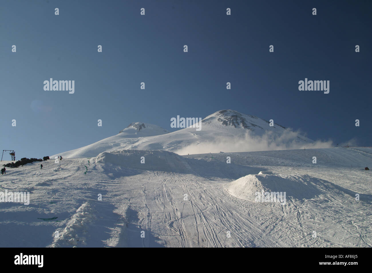 Mountains landscape 21 - Evening Elbrus in pure blue sky and snowboard big-airs, Caucasus, Elbrus region, Kabardino-Balkari - Stock Image