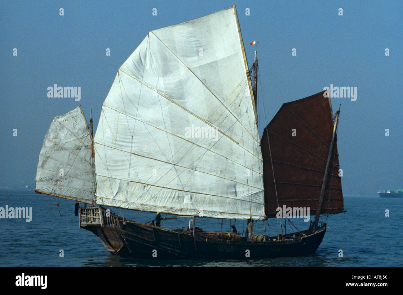 Stern & side view of traditional genuine old local sailing junk in the late 1970s in Victoria Harbour Hong Kong Island China - Stock Image