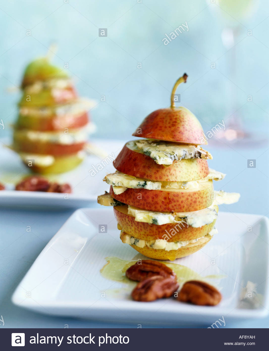 Pear with blue cheese and nut oil - Stock Image