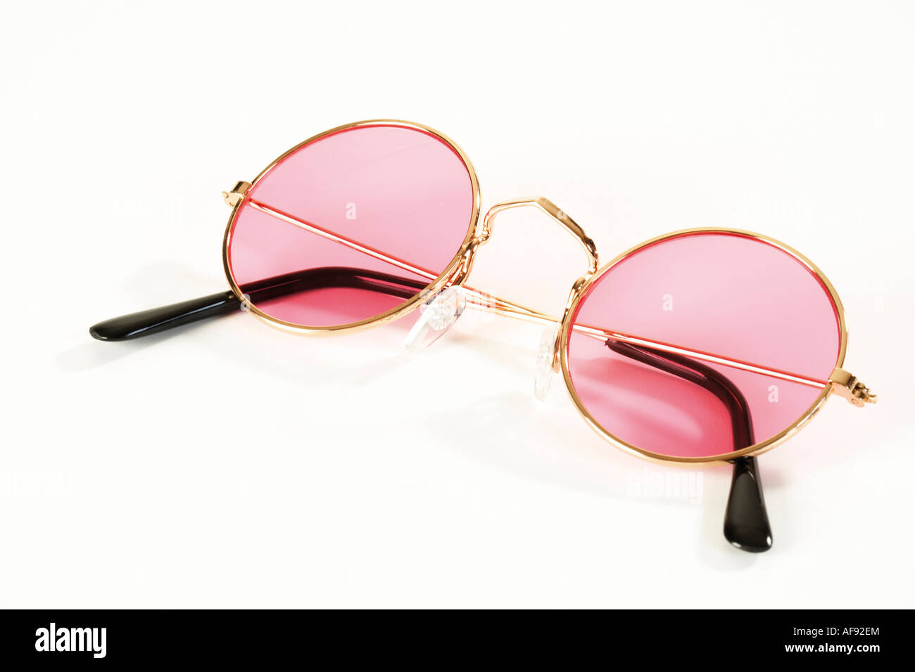 Pink metal-rimmed spectacles - Stock Image