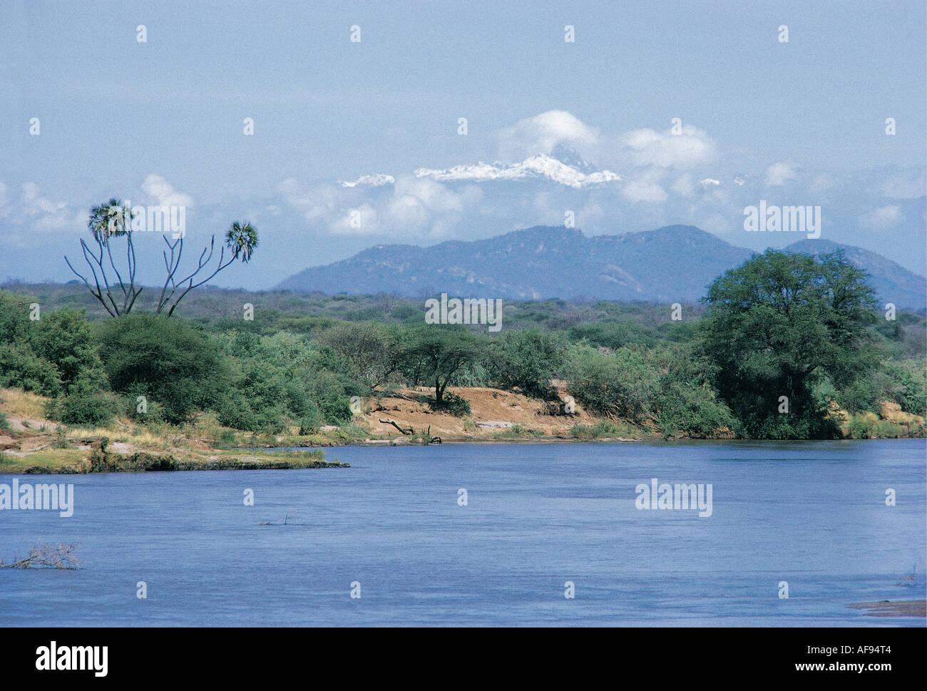 The Tana river and the distant snows of Mount Kenya Meru National Park Kenya East Africa The Tana is Kenya s biggest river - Stock Image