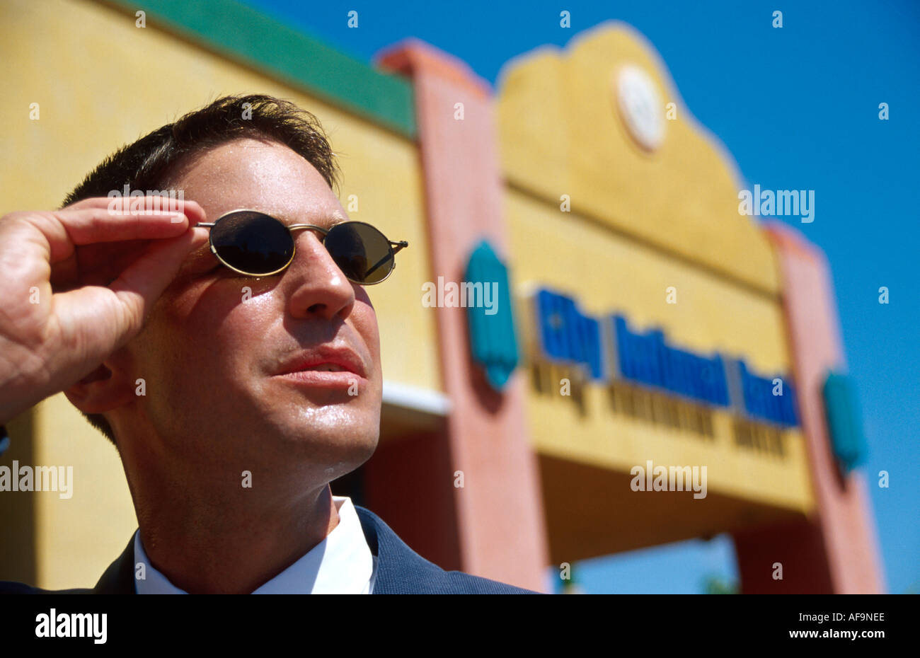3629c8c4862 Miami Beach Florida White male businessman sunglasses near City National  Bank - Stock Image