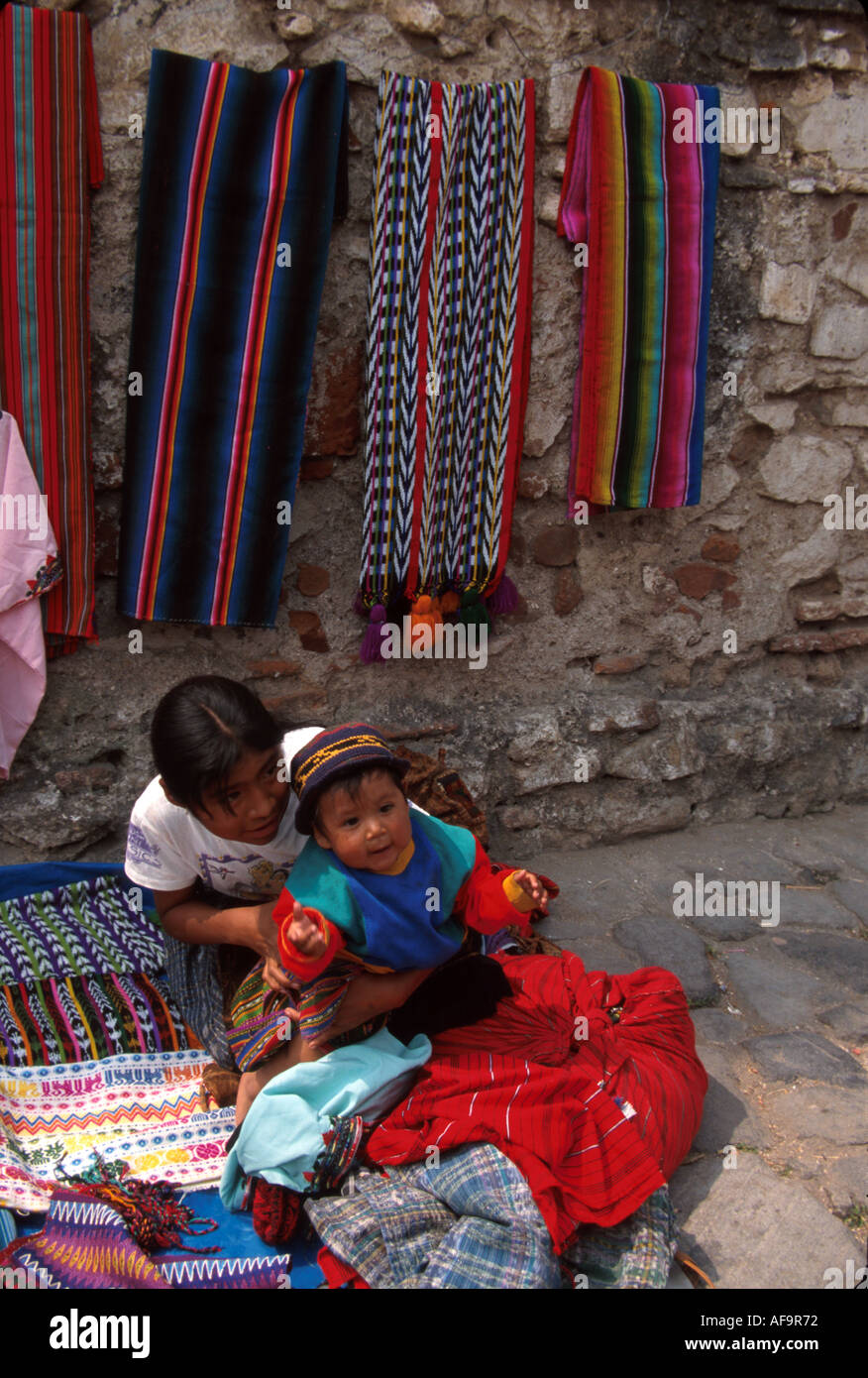 Guatemala La Antigua colonial capitol until earthquake Cakchiquel Indigenous family vendors - Stock Image