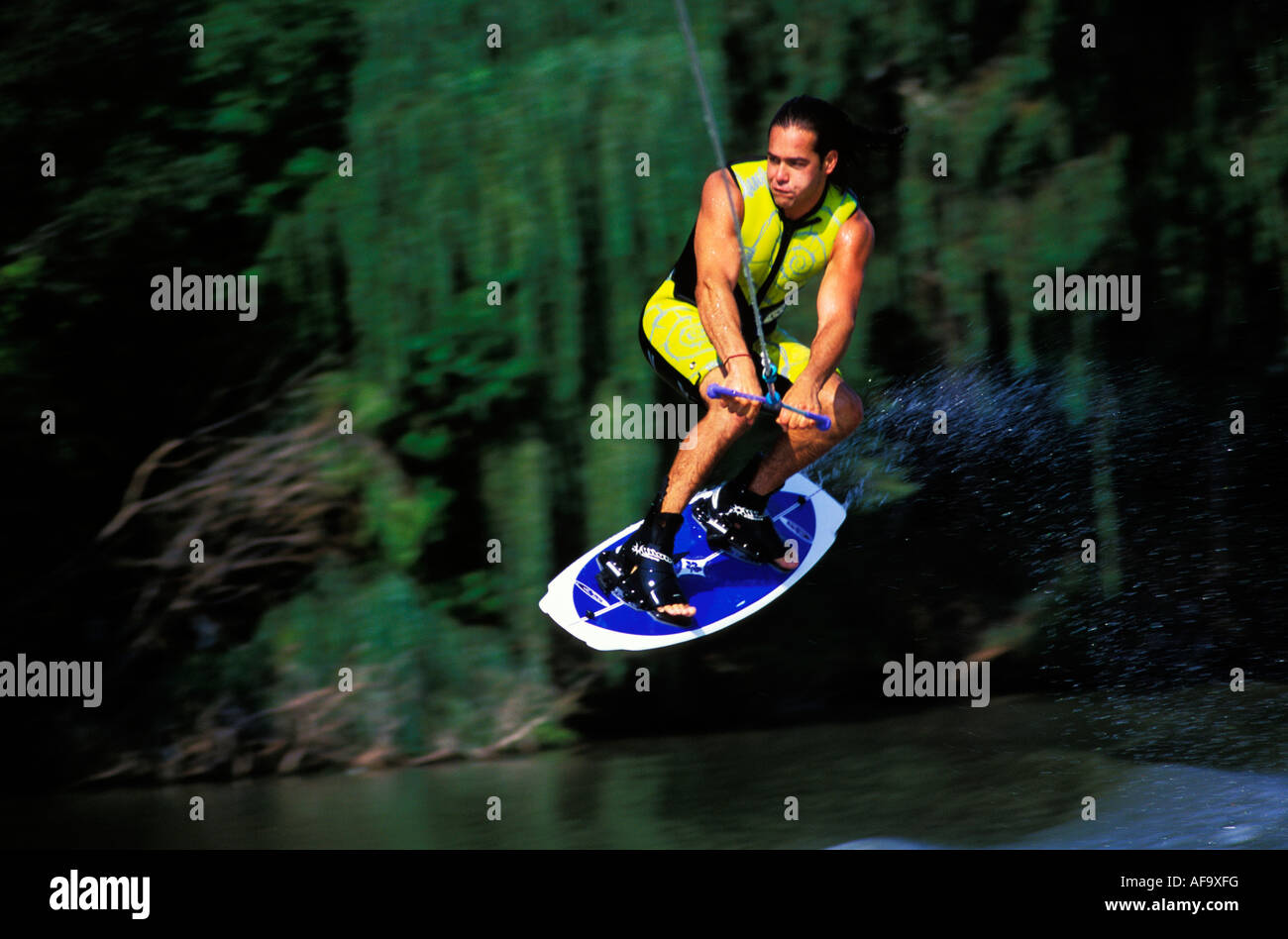 Water-skier on a wakeboard jumping South Africa - Stock Image