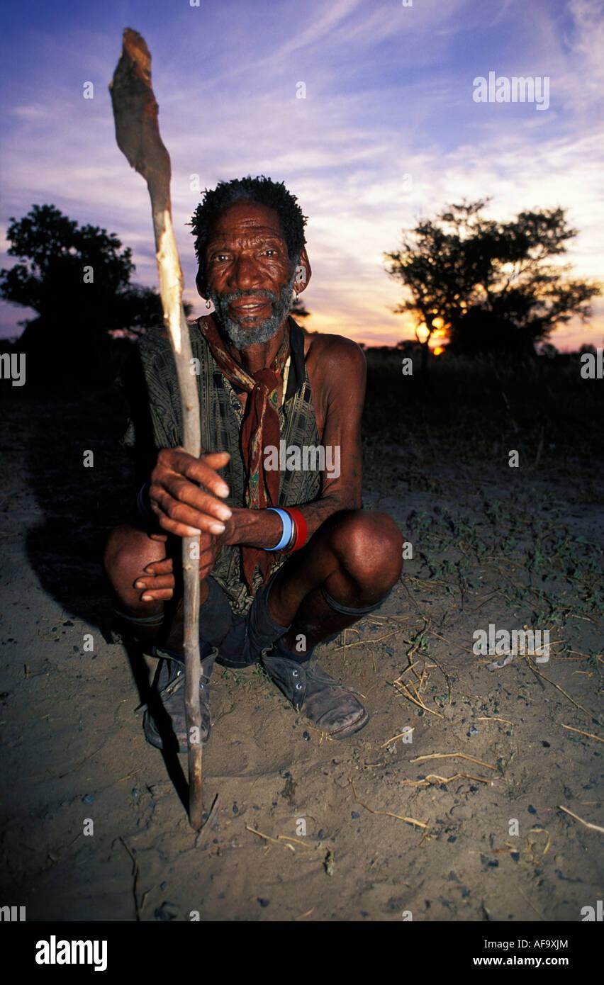 Portrait of old Kua bushman with spear Molapo, Central Kalahari Game Reserve; Botswana - Stock Image