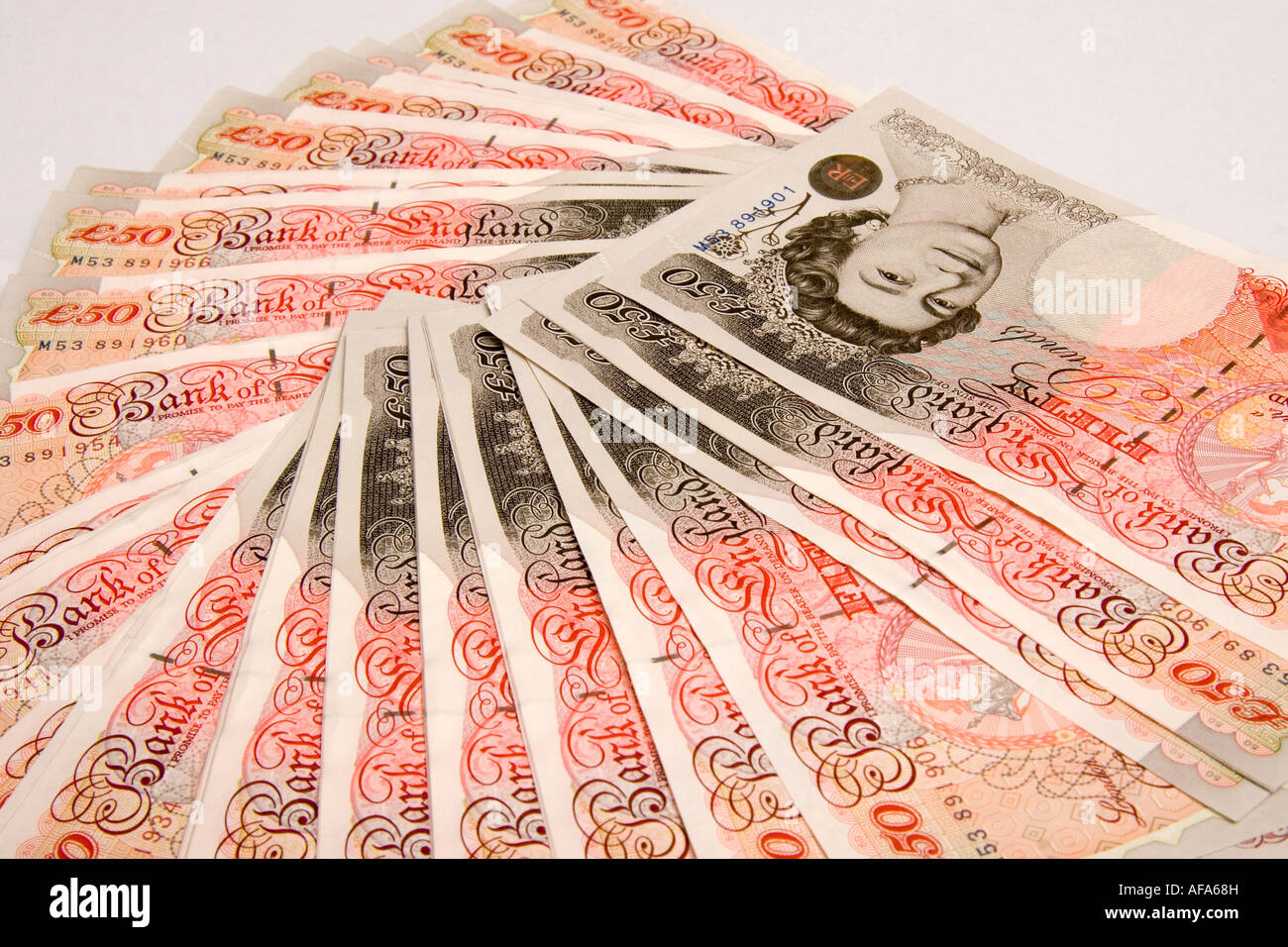 A fan of five thousand pounds in new fifty pound notes 5000 50 - Stock Image
