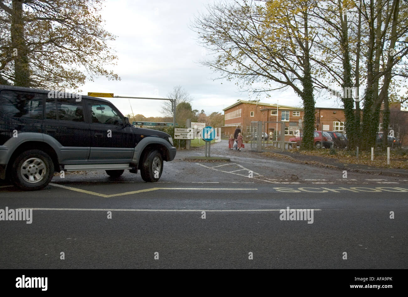 Large 4x4 Car Doing the School Run - Stock Image