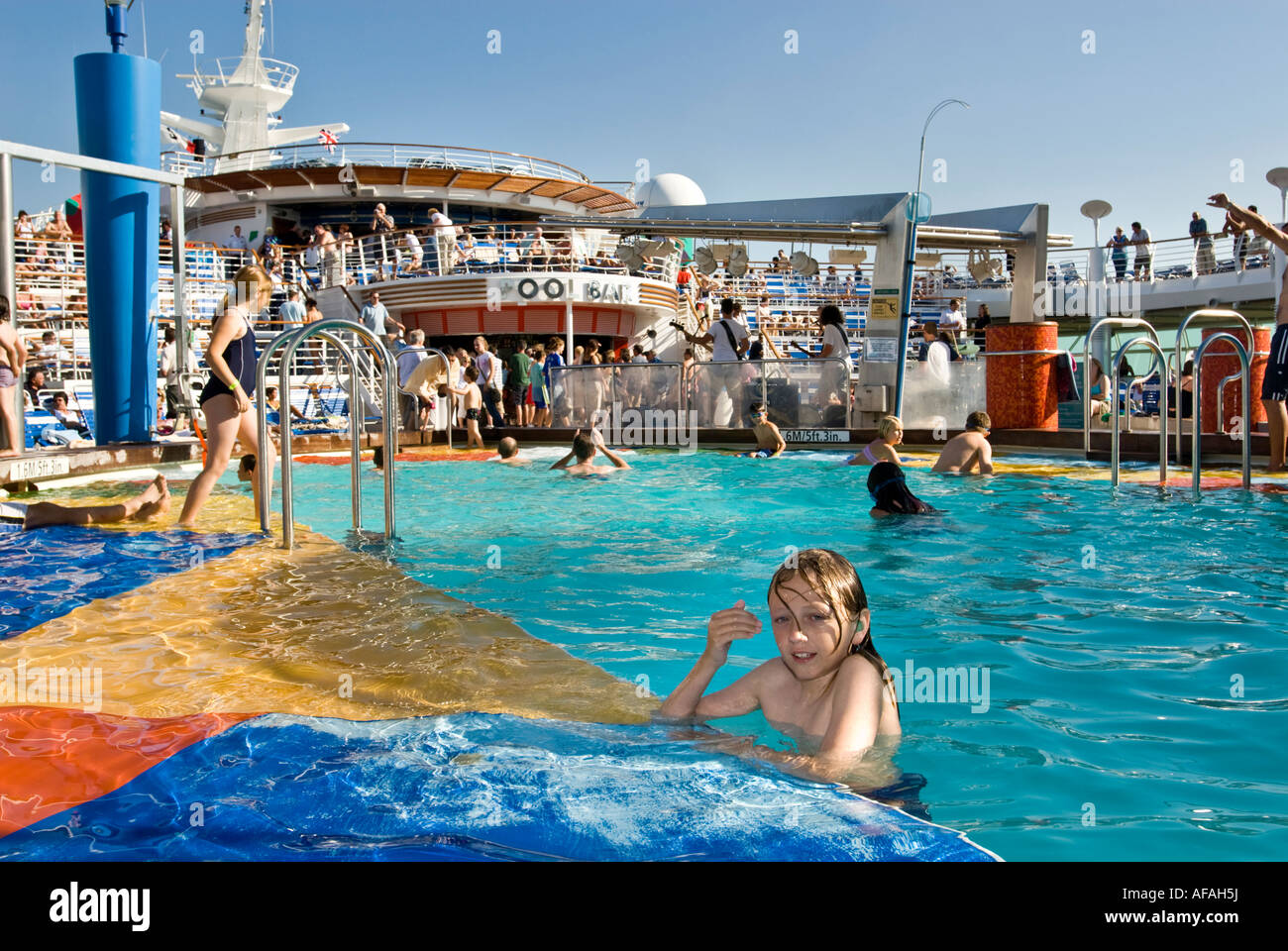 The massive seawater pool area on a cruise liner - Stock Image