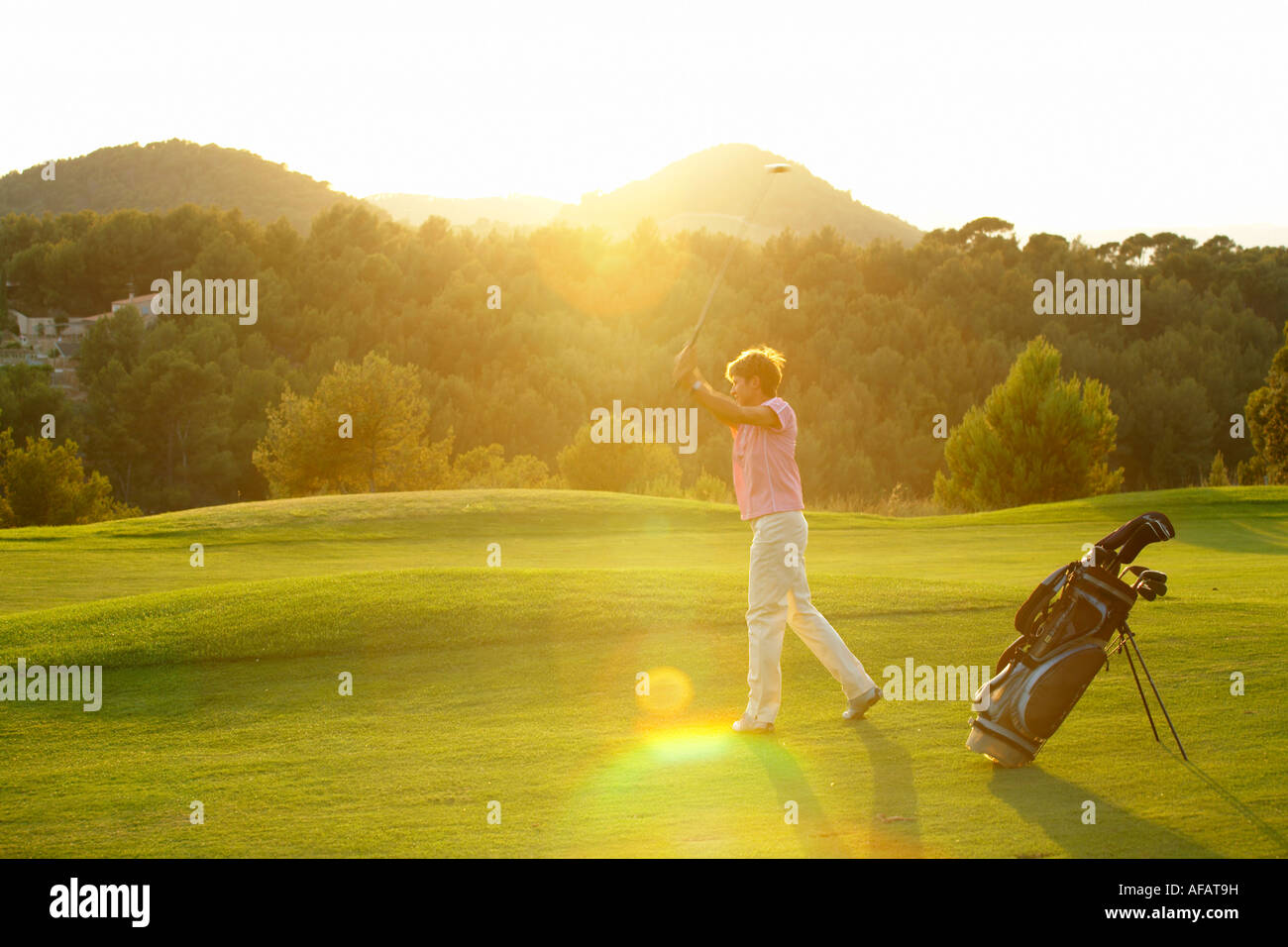 Golfer on the fairway - Stock Image