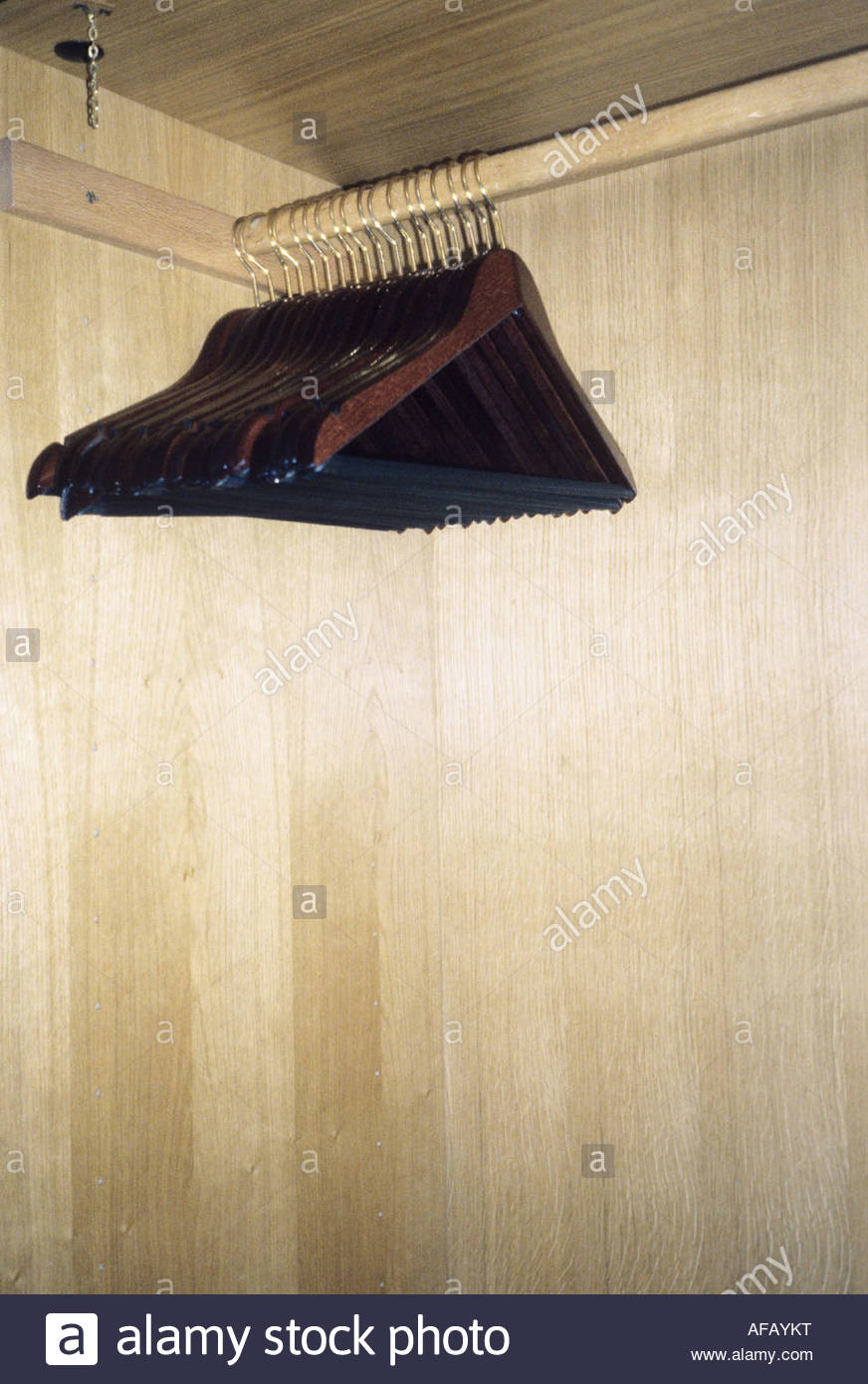 Clothes rail with coat hangers - Stock Image