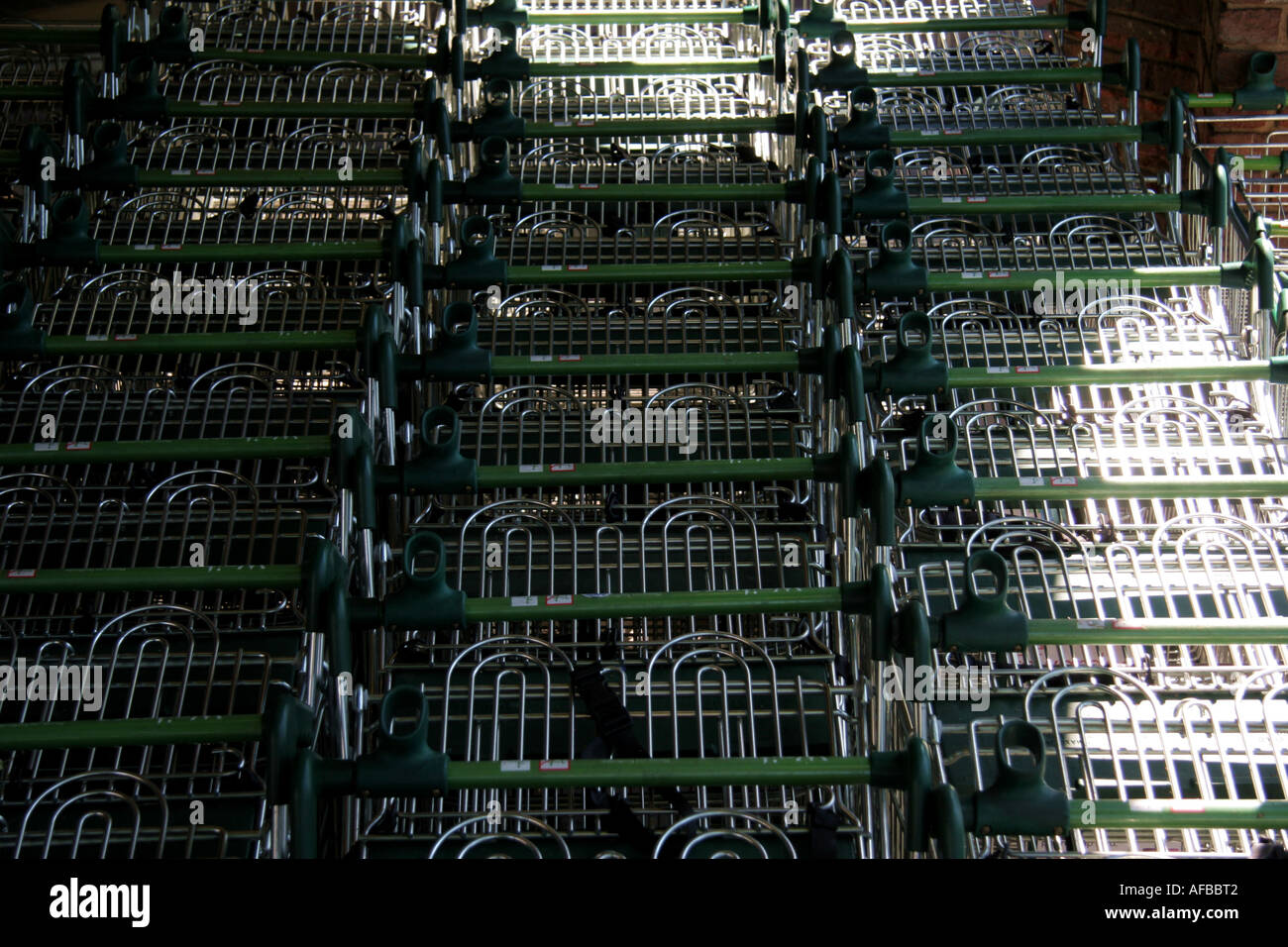 Stacked shopping trollies - Stock Image