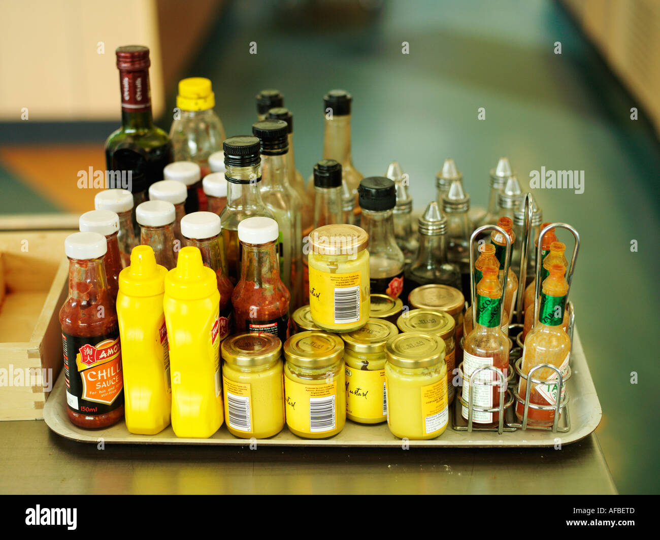Tray of assorted sauces and condiments - Stock Image