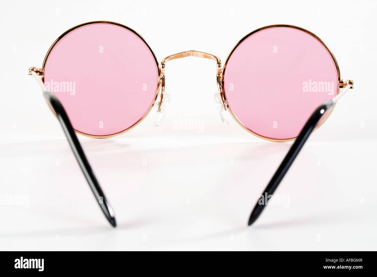 Pink metal-rimmed spectacles, close-up - Stock Image