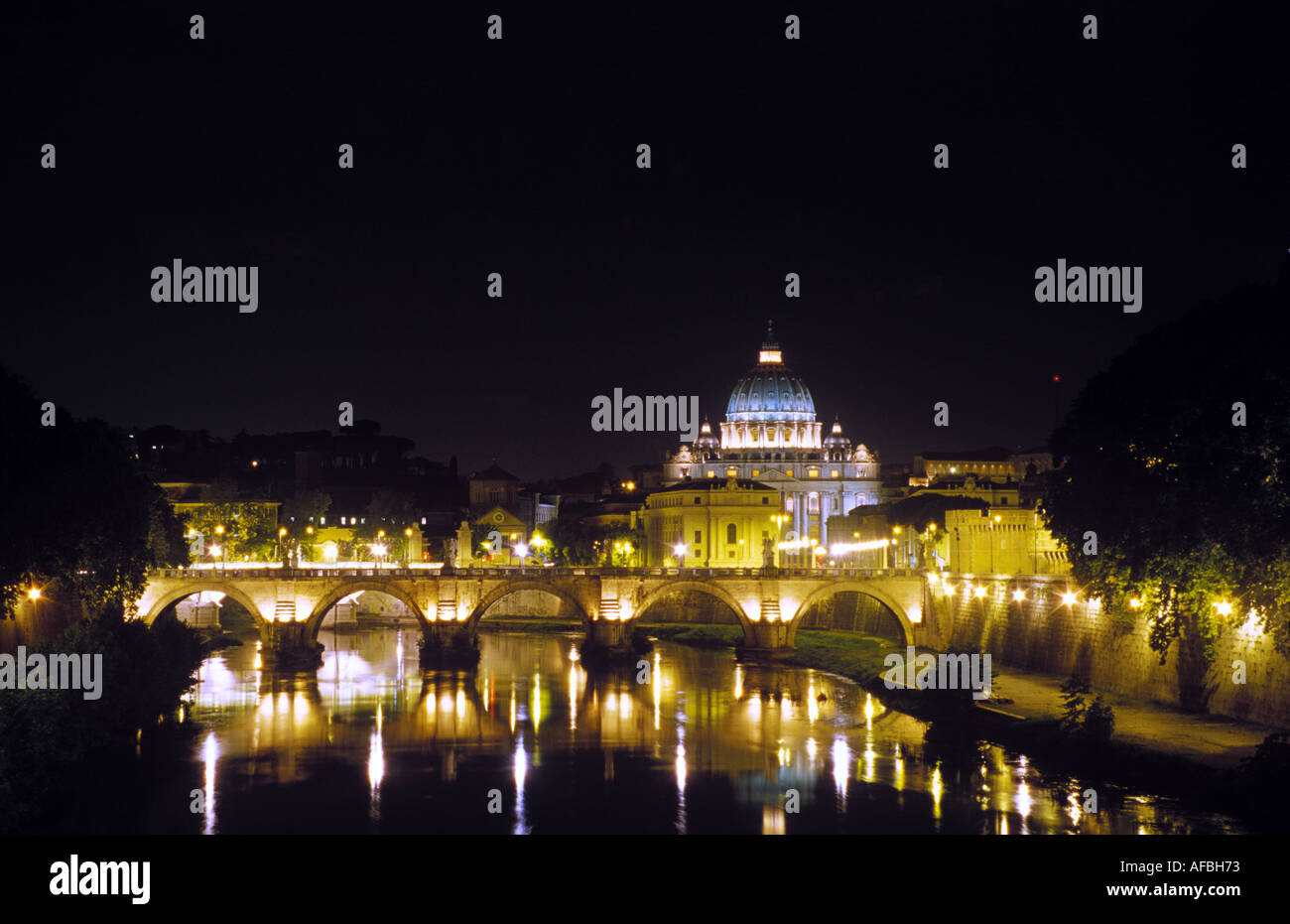 A distant view across the Tiber River of the dome of Saint Peter s Basilica in the Vatican Rome - Stock Image