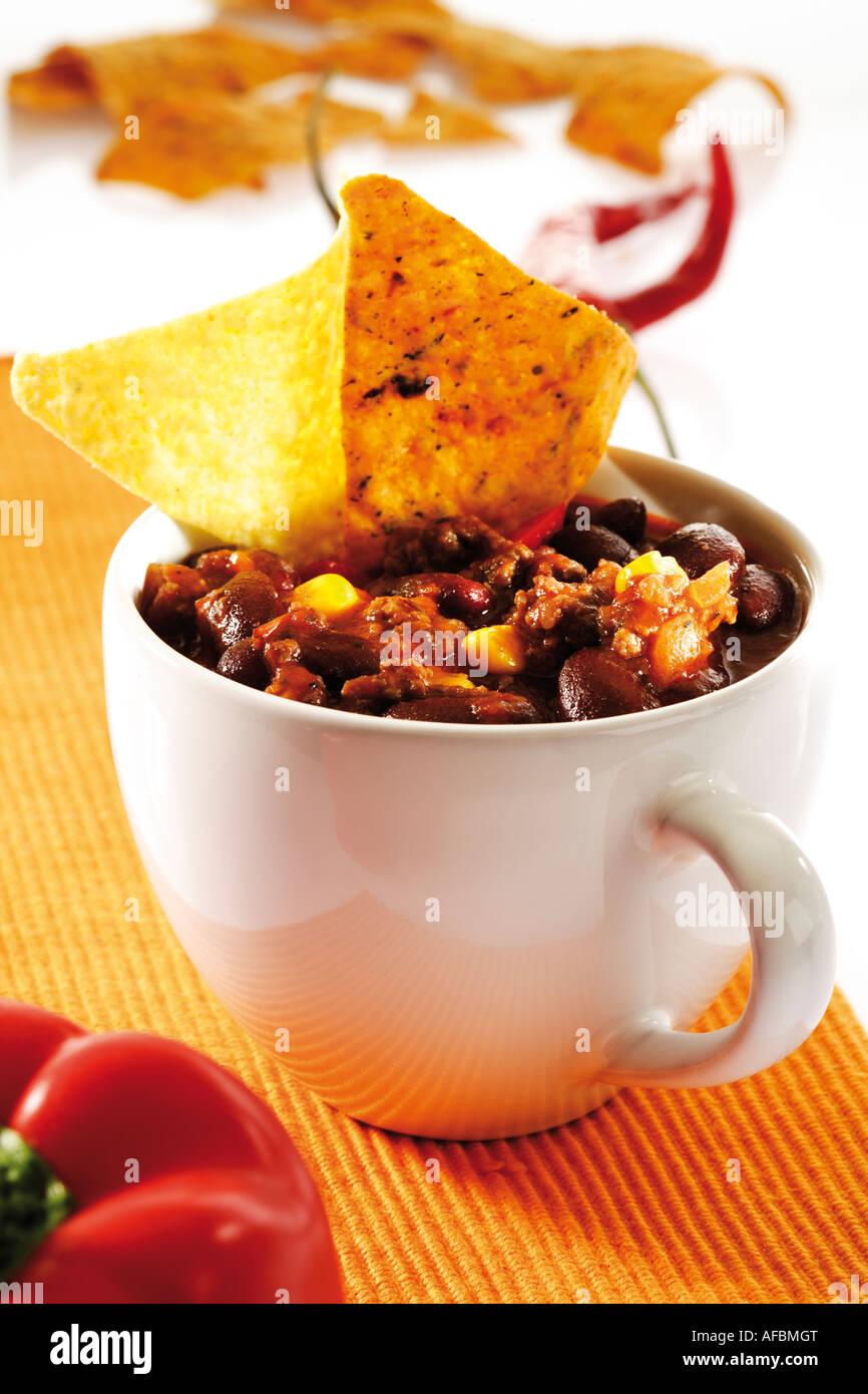 Chili con carne in cup with tortilla chips - Stock Image