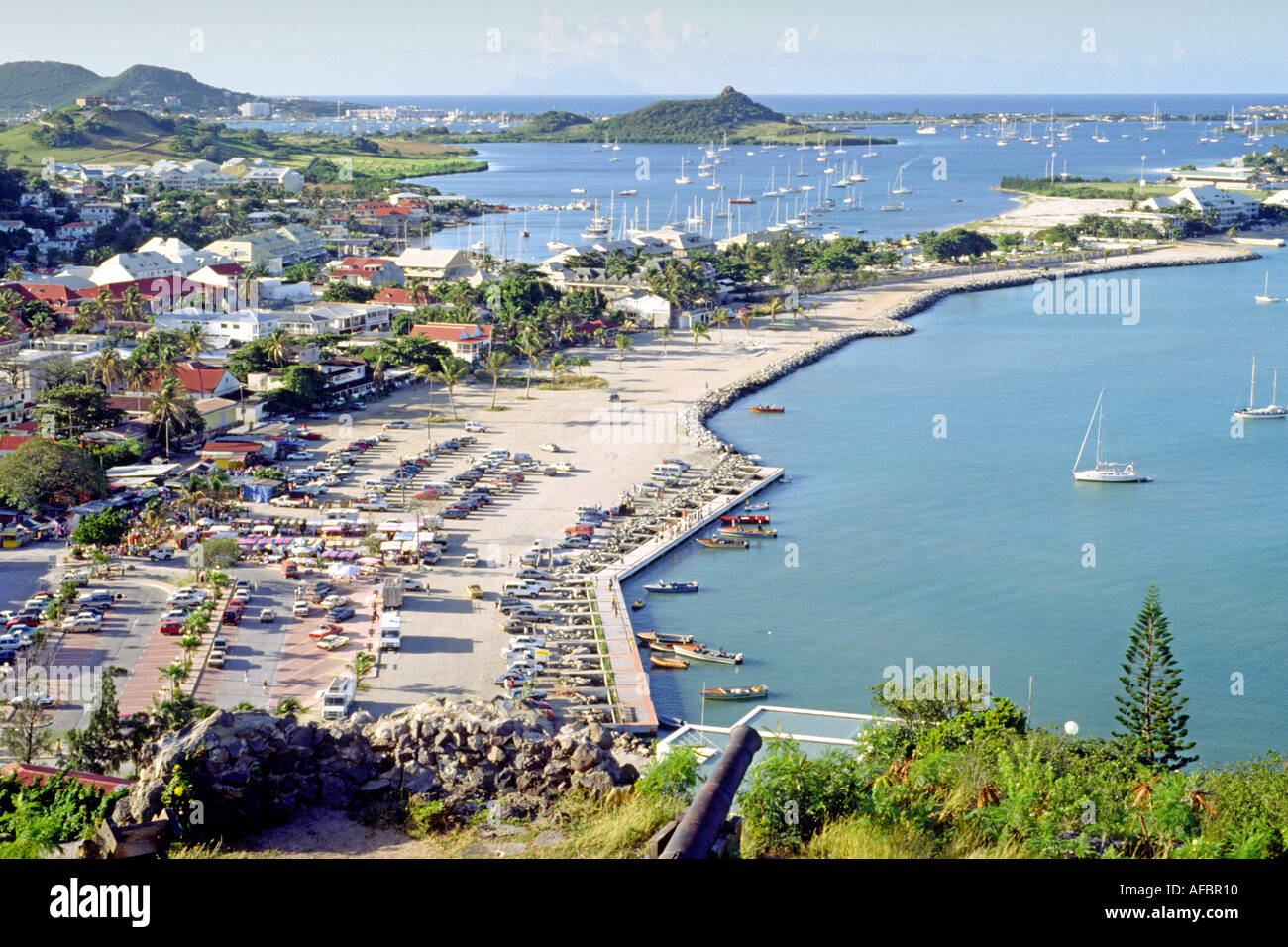 A view of the Simpson Bay lagoon and the town of Marigot on the French island of Saint Martin in the Caribbean. - Stock Image