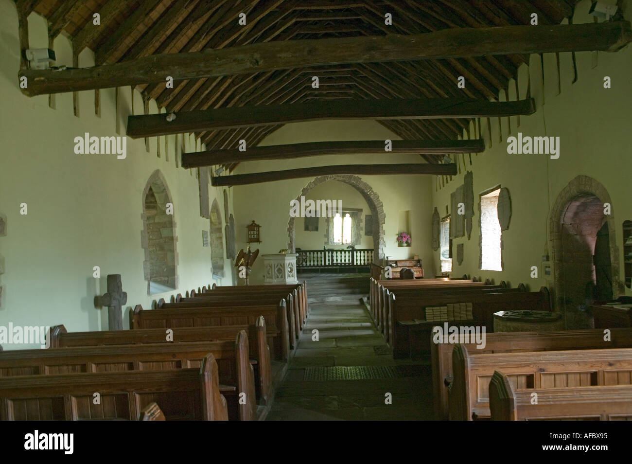 Interior St Martins church affected by subsidence Cwmyoy Mid Wales UK - Stock Image