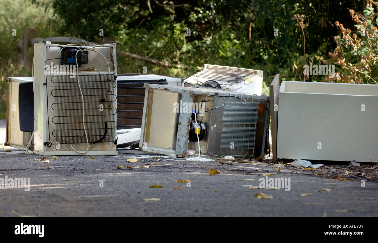 Fly-tipping: fridges and other white goods lie dumped in countryside layby. Picture by Jim Holden. - Stock Image