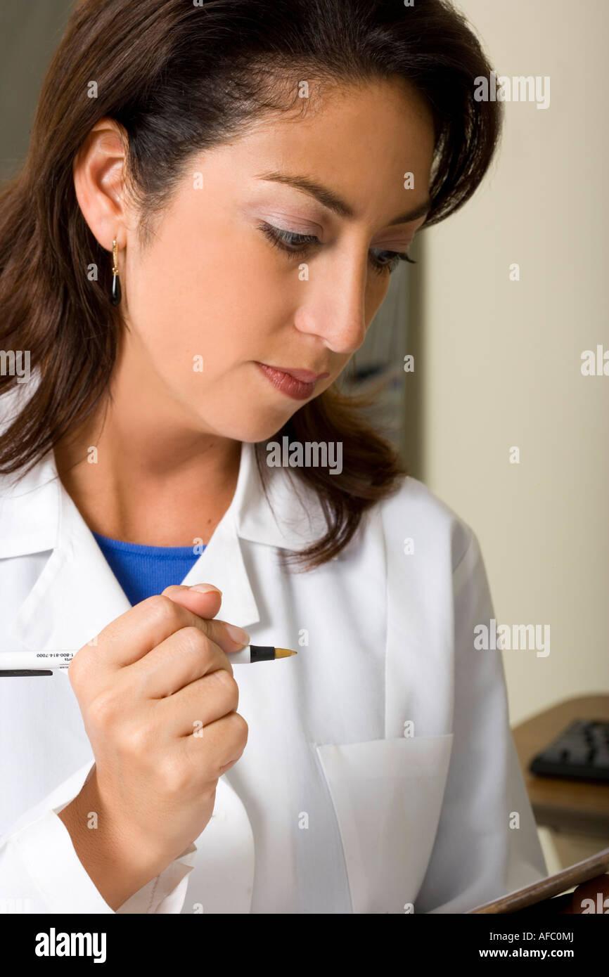 Nurse, researcher or technician updates records. - Stock Image