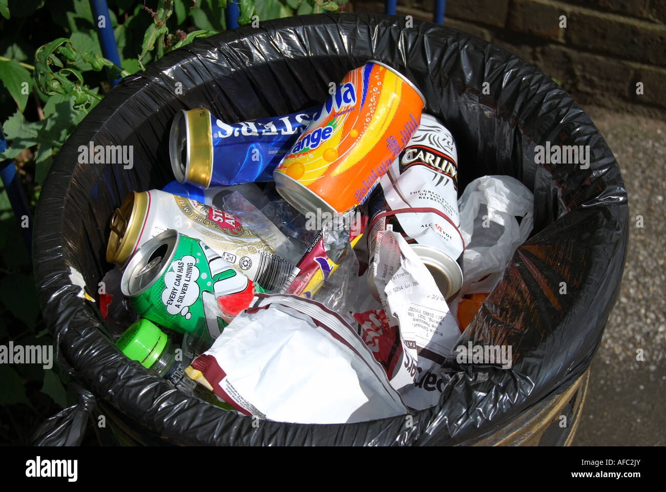 Rubbish bin, empty cans Woking, Surrey, England, United Kingdom - Stock Image