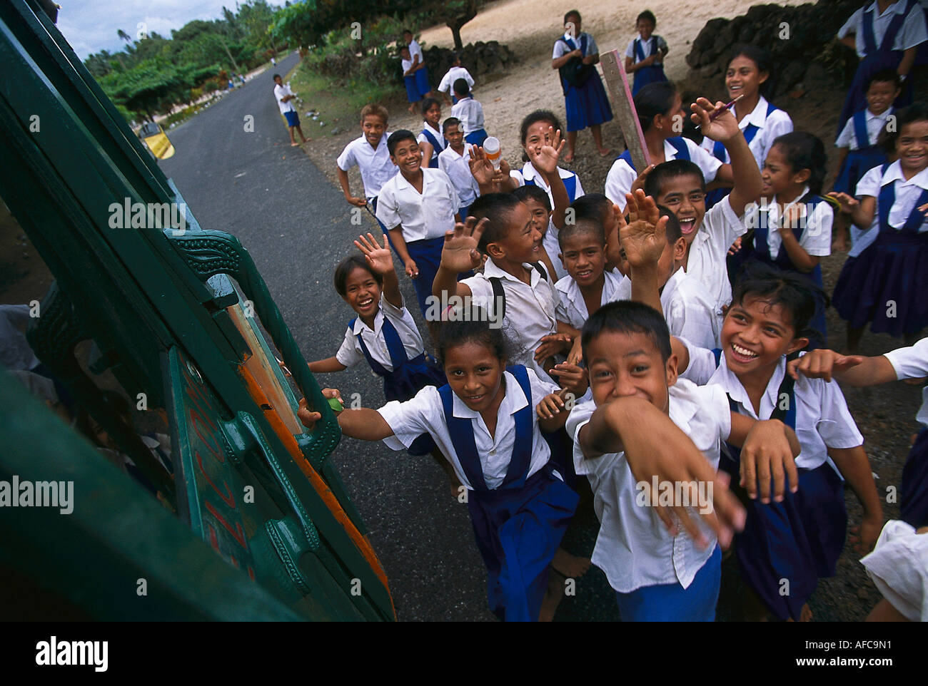 Ecotour Bus and Schoolkids, near Utulaelae Upolu, Samoa - Stock Image
