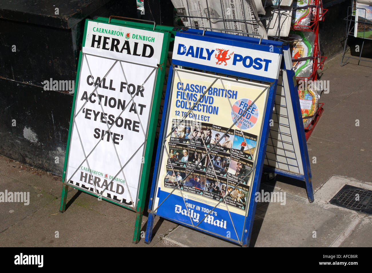 Newspaper advert boards outside shop - Stock Image