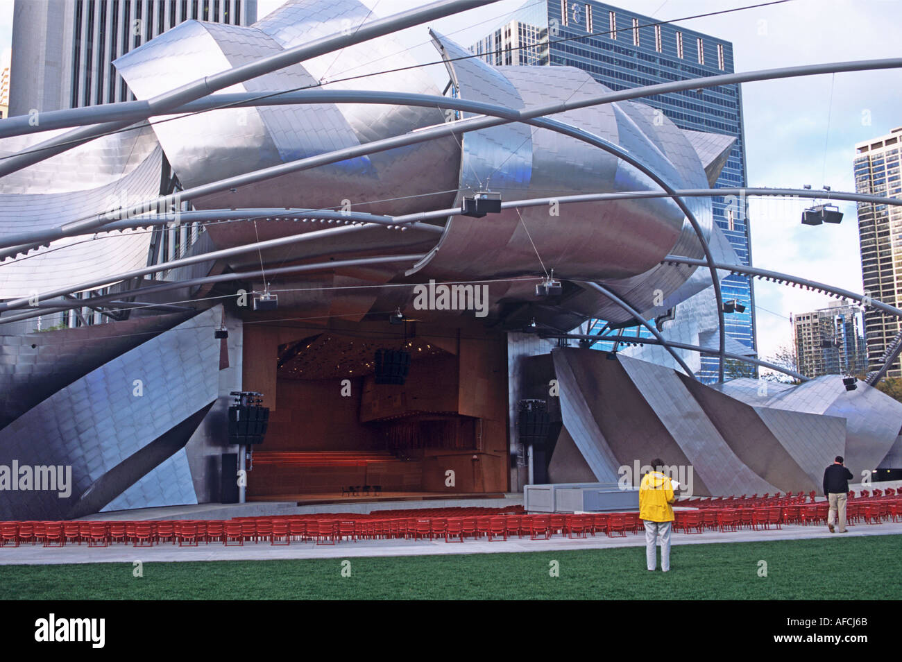 The Jay Pritzker Pavilion within Chicago's Millennium Park bears the vibrant signature of architect Frank Gehry - Stock Image