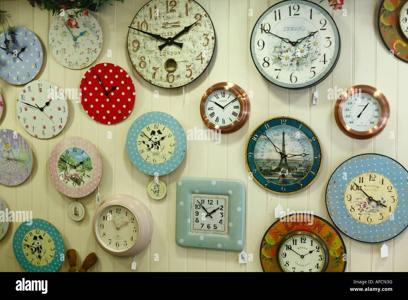Selection of wall clocks on display for sale. - Stock Image