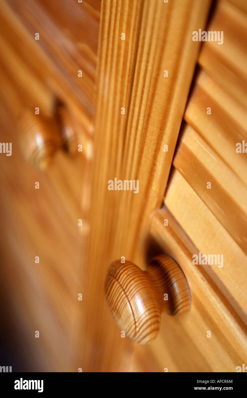 DETAIL OF PINE DOOR KNOBS ON CLOSED PANEL LOUVRE DOORS - Stock Image