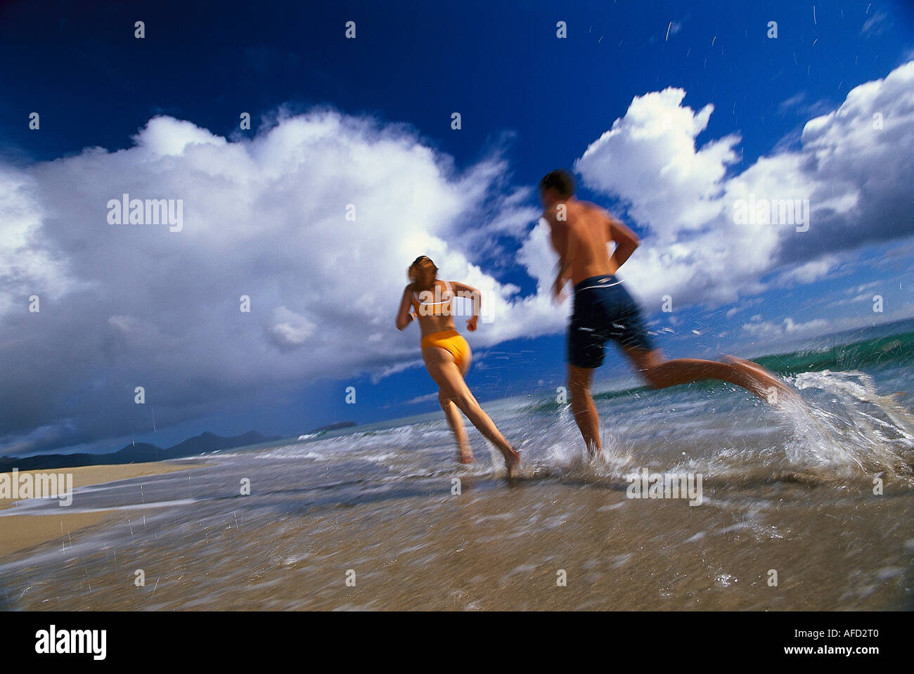 Couple jogging along the beach, Porto Santo, Madeira, Portugal - Stock Image